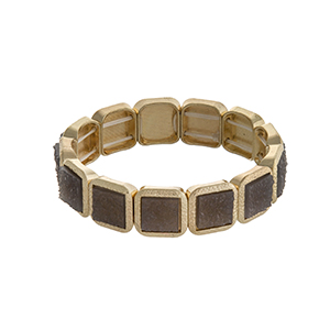 Gold tone square stretch bracelet with gray stones.