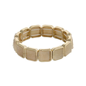 Gold tone square stretch bracelet with ivory stones.