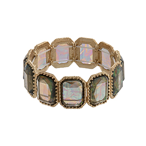 Gold tone rectangular stretch bracelet with green iridescent cabochons.