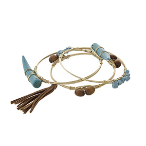 Gold tone wire wrapped bracelet set with brown beads, turquoise chip stones, and turquoise horns. Set of three.