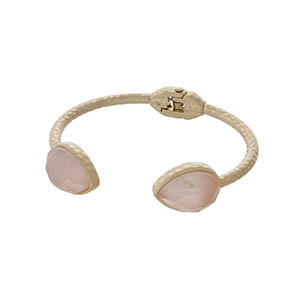 Hammered gold tone cuff bracelet with teardrop pale pink stones.