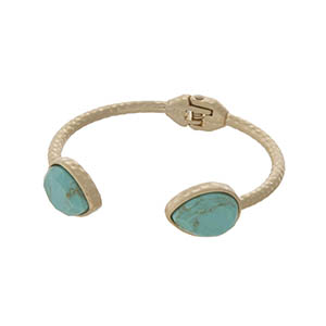 Hammered gold tone cuff bracelet with teardrop turquoise stones.
