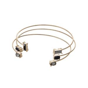 Set of three dainty gold tone cuff bracelets with black and gray rhinestones.