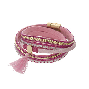 "Pink and gold multi-cord magnetic bracelet with tassel accent. Approximately 15.5"" in length."