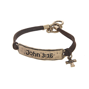 """Brown faux suede toggle bracelet featuring a gold tone stamped John 3:16 bar with a cross charm. Approximately 9"""" in length."""
