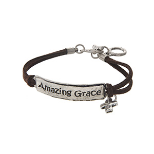 """Brown faux suede toggle bracelet featuring a silver tone stamped Amazing Grace bar with a cross charm. Approximately 9"""" in length."""