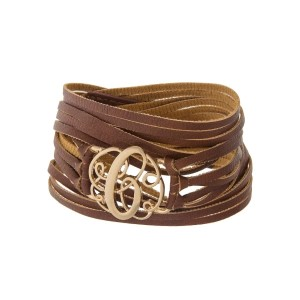 """Brown faux leather wrap bracelet with a gold tone 'C' initial focal. Approximately 22"""" in length."""