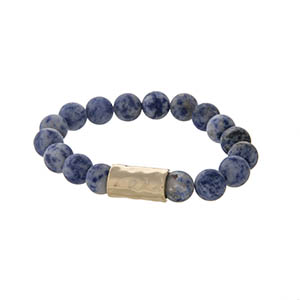 Navy blue natural stone stretch bracelet with a hammered gold tone bar.