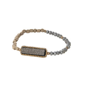 Gold tone stretch bracelet featuring a gray faux druzy stone and hematite beads.