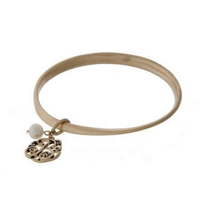 Burnished gold tone twist bangle with a script 'B' initial and freshwater pearl charms.