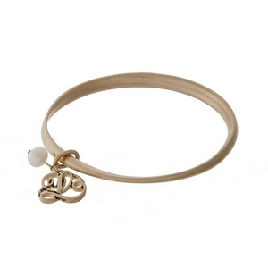 Burnished gold tone twist bangle with a script 'L' initial and freshwater pearl charms.