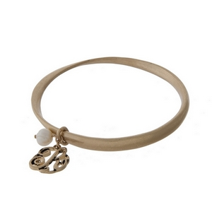 Burnished gold tone twist bangle with a script 'R' initial and freshwater pearl charms.