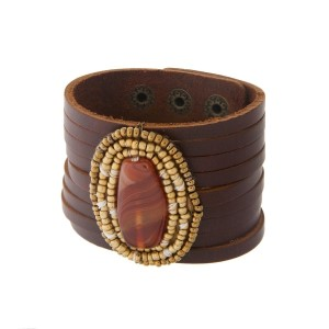 Genuine leather snap bracelet with an orange and gold beaded focal.