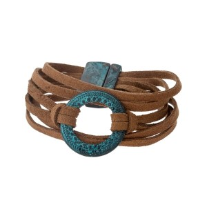 Tan suede bracelet with a burnished patina circle and magnetic closure.