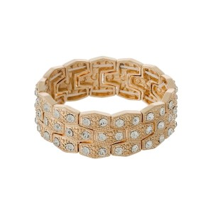 Gold tone interlocking stretch bracelet with clear rhinestones.