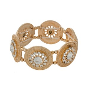 """Gold tone stretch bracelet displaying textured circles accented with clear rhinestones. Approximately 1.25"""" in length."""