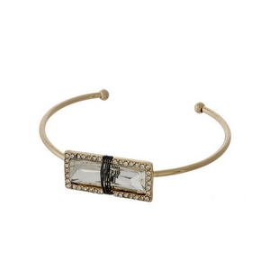 Dainty gold tone cuff bracelet with a wire wrapped, clear rhinestone, accented with pave rhinestones.