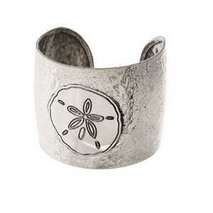 "Silver tone, handmade brass cuff bracelet with a sand dollar. Approximately 2"" in width."