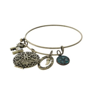 Burnished gold tone bangle bracelet with elephant, locket, and clover charms.