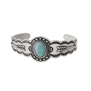 Silver tone cuff bracelet with a turquoise stone.