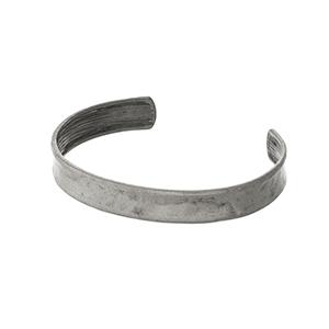 Hammered silver tone cuff bracelet.
