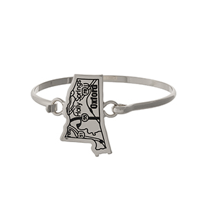 Silver tone bangle bracelet with the city map of Oxford, Mississippi stamped on the state shape.
