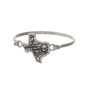 Silver tone bangle bracelet with the city map of College Station, Texas stamped on the state shape.