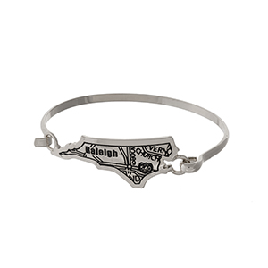 Silver tone bangle bracelet with the city map of Raleigh, North Carolina stamped on the state shape.