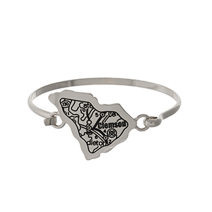 Silver tone bangle bracelet with the city map of Clemson, South Carolina stamped on the state shape.