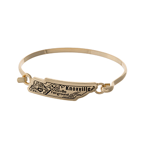 Gold tone bangle bracelet with the city map of Knoxville, Tennessee stamped on the state shape.