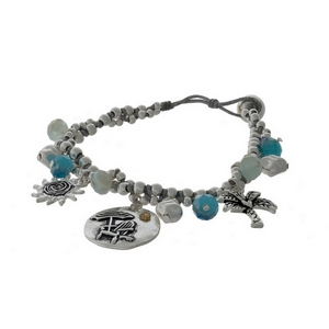 Silver tone and gray cord bracelet with beach themed charms and a button closure.
