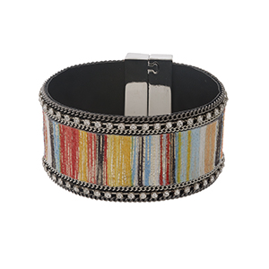 "Silver tone magnetic bracelet with a pink, orange and blue striped fabric, accented with clear rhinestones. Approximately 1.25"" in width."