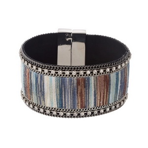 "Silver tone magnetic bracelet with a blue, brown and turquoise striped fabric, accented with clear rhinestones. Approximately 1.25"" in width."