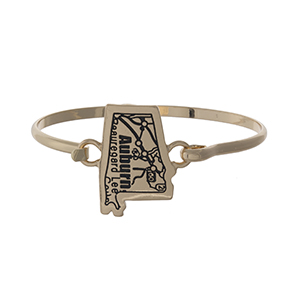 Gold tone bangle bracelet with the city map of Auburn, Alabama stamped on the state shape.