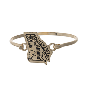 Gold tone bangle bracelet with the city map of Athens, Georgia stamped on the state shape.