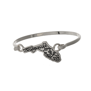 Silver tone bangle bracelet with the city map of Tallahassee, Florida stamped on the state shape.