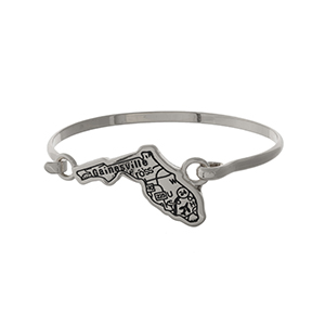 Silver tone bangle bracelet with the city map of Gainesville, Florida stamped on the state shape.
