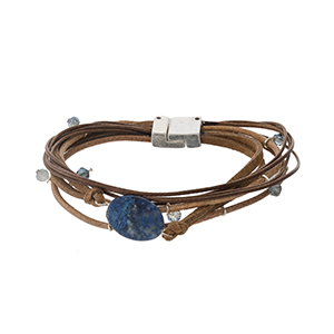 Brown cord bracelet with a navy blue semi-precious stone and a magnetic closure.