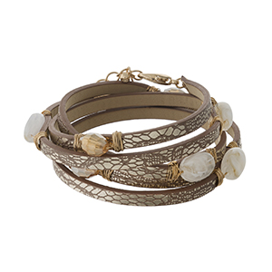 Brown faux leather wrap bracelet with ivory stones and gold tone accents.