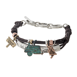 """Brown waxed cord bracelet featuring a silver tone bar stamped with """"Happy Camper"""" and accented with gold, patina, and silver tone charms."""