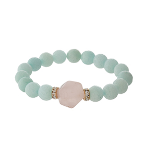 Mint green beaded stretch bracelet with a pale pink stone and gold tone accents.