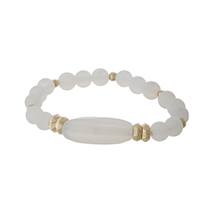 White beaded stretch bracelet with gold tone beaded accents.
