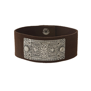 Brown faux leather snap bracelet with a hammered and stamped silver tone focal.