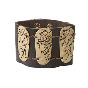 "Brown leather snap bracelet with stamped gold tone pieces. Approximately 2.25"" in width."