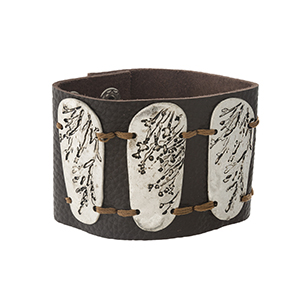 "Brown leather snap bracelet with stamped silver tone pieces. Approximately 2.25"" in width."