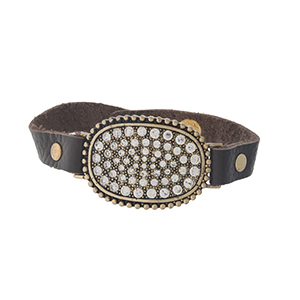 Brown leather snap bracelet with a gold tone focal, accented with clear rhinestones.