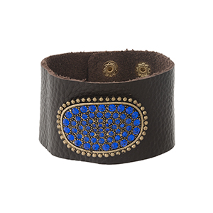 Brown leather snap bracelet with a gold tone and blue rhinestone pave focal.