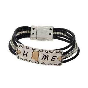 "Silver tone and black cord bracelet displaying  a ""Home"" focal and a gold tone state shape of Mississippi."