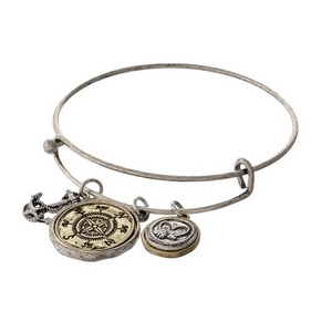 "Silver tone adjustable bracelet with a stamped charm saying ""Friends are always close at heart."""