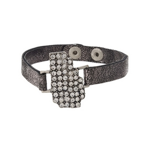 Gunmetal gray, faux leather snap bracelet with the state shape of Georgia, accented by clear rhinestones.